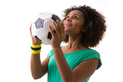 Brazilian woman holding a soccer ball on white background Stock Image