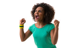 Brazilian woman holding a soccer ball on white background Royalty Free Stock Photography