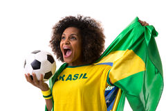 Brazilian woman holding a soccer ball on white background Stock Photo