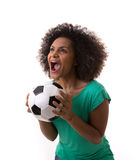 Brazilian woman playing with the soccer ball on white background Royalty Free Stock Image