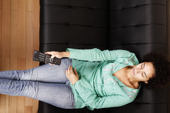 Brazilian woman with remote control Stock Photo