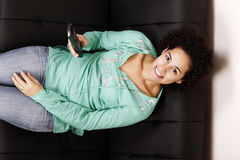 Brazilian woman with remote control Royalty Free Stock Image