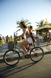 Brazilian Woman Riding Bike Ipanema Rio Royalty Free Stock Photos