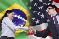 Brazilian woman shaking hands with American person Royalty Free Stock Photo