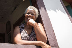 Brazilian woman smiling from the window Stock Photography