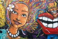 Brazilian Woman Street Art Graffiti. RIO DE JANEIRO, BRAZIL - MARCH 06, 2015: Street art in graffiti depicts smiling Brazilian woman with brightly colored hair royalty free stock photos