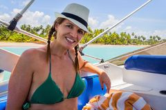 Brazilian woman in a tour on a motor boat in Cumbuco - PE - Brazil. Brazilian woman on a motor boat in Cumbuco - PE - Brazil stock photo