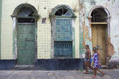 Brazilian Women Walking Past Neglected Architecture Royalty Free Stock Photos