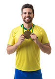 Brazilian young fan man holding a medal on white background Stock Image
