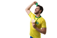 Brazilian young fan man holding a medal on white background Stock Photos