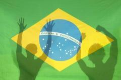 Brazilians Celebrating Shadows on Brazil Flag Stock Photography