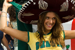 Brazillian Lady dons Mexican supporters garb Stock Images