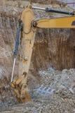 Brazo del excavador en la acción Fotografía de archivo