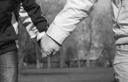 Brazo del hijo y brazo del padre Imagen de archivo