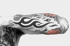 Brazo del tatuaje Imagen de archivo libre de regalías