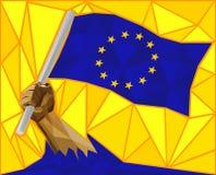 Brazo fuerte que aumenta la bandera de la unión europea Foto de archivo