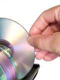 Brazo que selecciona el disco óptico de almacenaje de datos Fotos de archivo