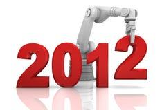 Brazo robótico industrial que construye 2012 años Imágenes de archivo libres de regalías