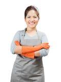 Brazos cruzados guantes de goma que llevan del ama de casa asiática Imagen de archivo libre de regalías