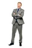 Brazos felices del hombre de negocios doblados aislados en blanco Fotografía de archivo libre de regalías