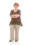 Brazos mayores de la mujer cruzados Foto de archivo libre de regalías