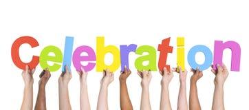 Brazos multiétnicos aumentados celebrando la celebración del texto Fotografía de archivo libre de regalías