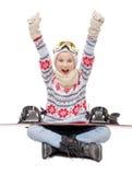 Brazos que se sientan del adolescente feliz en el aire, a los deportes de invierno Imagen de archivo