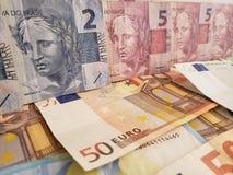 brazylijscy banknoty i europejczyków rachunki zdjęcia stock