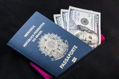 Brazylijski paszport i dolary fotografia stock