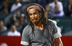 BRD Nastase Tiriac Trophy Charity Match. Yannick Noah fakes crying in a charity match at BRD Nastase Tiriac Trophy (ATP) Open at BNR Arena, in Bucharest, 20 sept royalty free stock photo