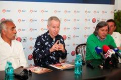 BRD Nastase Tiriac Trophy press conference. BUCHAREST, ROMANIA- APRIL 24: John McEnroe, tennis legend of U.S. speaks to the media and gestures during BRD Nastase Stock Photo
