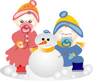 Brüder, die im Schnee spielen Lizenzfreies Stockfoto