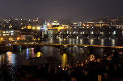 Bridges over Vltava river by night in Prague Stock Photography