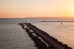 Breackwater in Albor. Sunset in the sea Royalty Free Stock Image