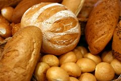 Bread №2. Fresh long loaf of bread and other batch Stock Photo