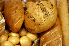Bread №3. Fresh long loaf of bread and other batch Royalty Free Stock Image