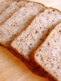 Bread 001. Slices of wholemeal bread on a bread board Royalty Free Stock Photography
