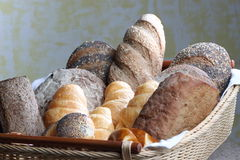 Bread. Fresh baked bread serve in a rattan basket with background wall royalty free stock photos