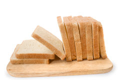 Bread. Ten slices of bread on a board are isolated on a white background Stock Photos