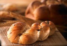 Bread. Variety of bread on table setting with mood lighting Royalty Free Stock Photos