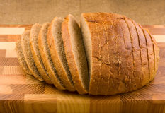 Bread. Sliced bread on the wooden plate Stock Photo