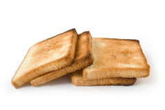 Bread. Four pieces of the fried bread isolated on a white background Royalty Free Stock Photos