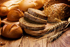 Bread. Various types of bread on wooden background Royalty Free Stock Image