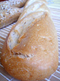 Bread. Close up with delicious bread, grain isolated on wood Stock Images