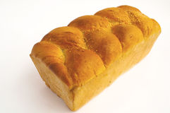 Bread. Roll of bread of golden colouron white background Royalty Free Stock Photos