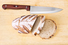 Bread. Fresh sliced loaf of bread on wooden board Royalty Free Stock Photo