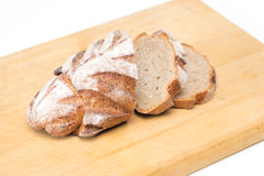 Bread. Fresh sliced loaf of bread on wooden board Royalty Free Stock Photos