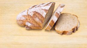Bread. Fresh sliced loaf of bread on wooden board Stock Photography