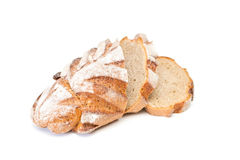 Bread. Fresh sliced loaf of bread on a white background Stock Images