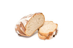 Bread. Fresh sliced loaf of bread on a white background Royalty Free Stock Images